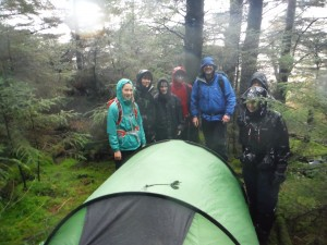 Putting up tents in the rain!